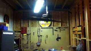 Wooden airplane propeller ceiling fan.