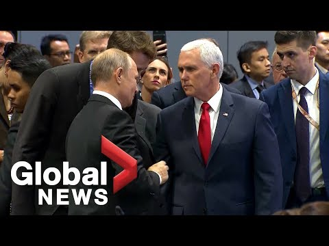 Mike Pence greets Vladimir Putin with handshake at ASEAN Summit
