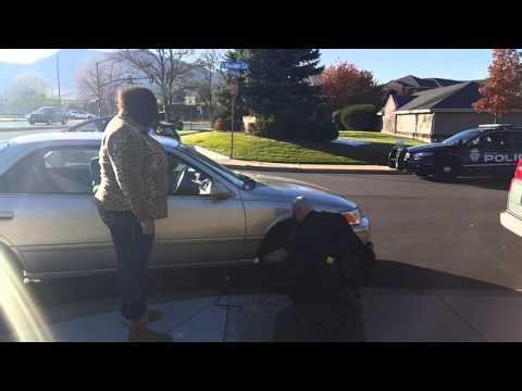 Boulder Colorado Police Officer changing flat tire for motorist