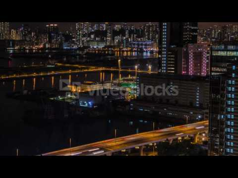 timelapse top view hong kong cityscape night skyline of the city near kowloon bay with ships and car