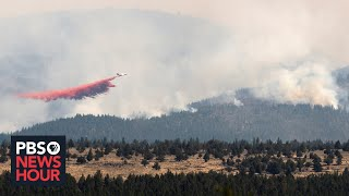 News Wrap: Fire crews pull away from Oregon Bootleg Fire over safety concerns