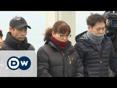 South Korean capsized ferry raised from the sea | DW English