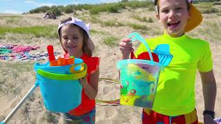 Max and Katy play water games on the beach