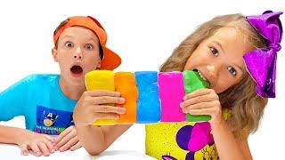 Katy and Max play with edible slime