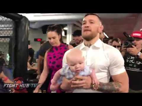 Conor McGregor walks in with his baby & girlfriend Dee Devlin dressed super sharp