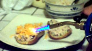 Tuna sandwich made with marble cheese melted with a propane torch