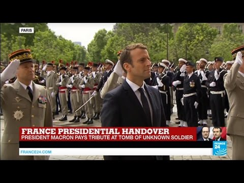 French President Emmanuel Macron pays homage to WWI Unknown Soldier at the Arc de Triomphe