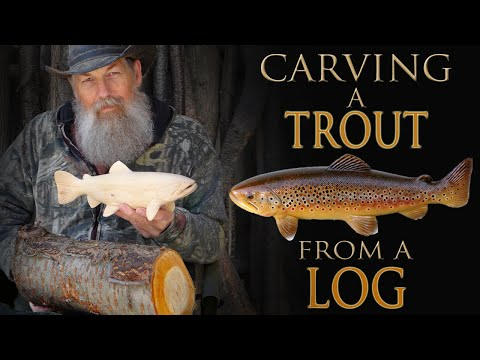 Carving A Wooden Brown Trout Fish From A Log