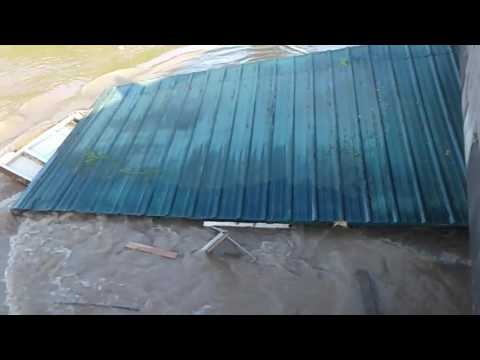 Cabin Smashes into Bridge as it Floats Down Flooded River in Arkansas