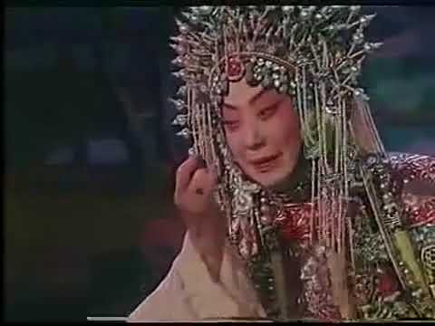 Mei Lang picking a flower