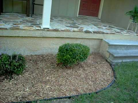 Mulch the front yard - YouTube