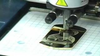 Personalizing a Pendant with a Roland MPX-90 Impact Printer