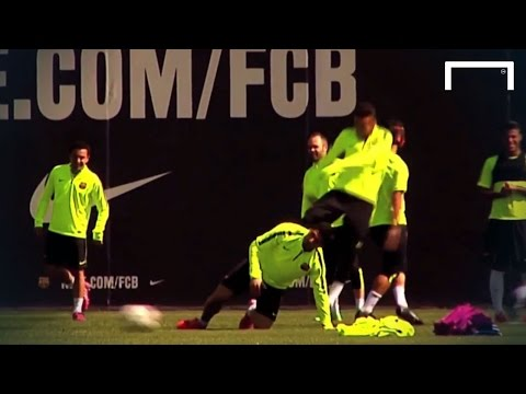 Neymar gives Suarez a kick during Barcelona training