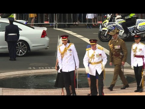Prince Harry and Meghan pay respects at ANZAC war memorial