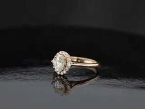 M.L. Oval Antique Style Rose Gold Halo Engagement Ring