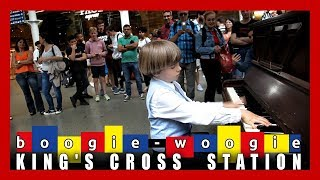 Public piano performance played boogie - woogie  by Olivier (9 years old) at King's Cross Station
