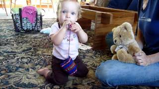 Ten Month Old Tot Dances with Teddy Bear