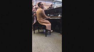 John Legend surprises commuters with a live performance at a London train station