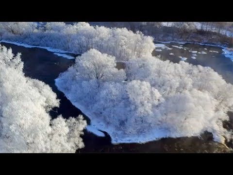 Rime island: Magnificent rime scenery along river in northeastern China