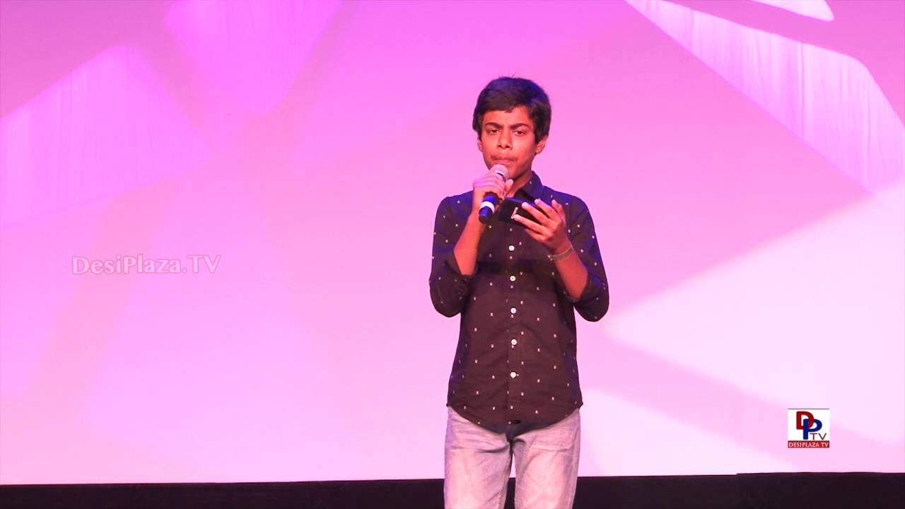Young participant singing at 9th AKKA World Kannada Conference
