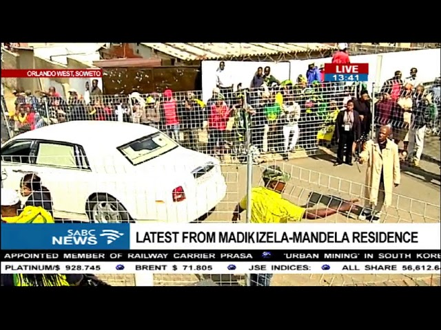 Family leaves for Mama Winnie's body.