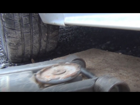 How To Jack Up A Car On Gravel Stone Or Dirt Using A Floor Jack