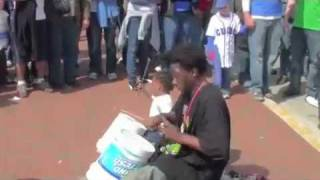 Street Drummer and His Baby Boy