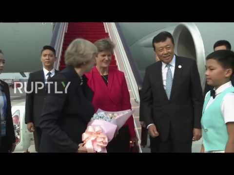 China: Theresa May and Philip Hammond touch down for G20 summit