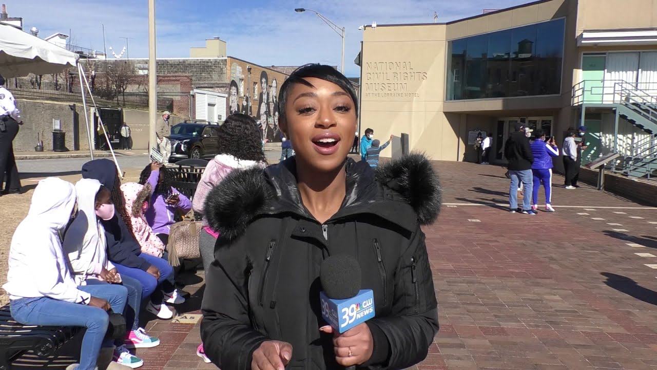 People gather at the Lorraine Motel to remember the life and legacy of Dr. Martin Luther King Jr.