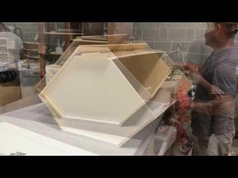 Diagonal corner wall cabinet assembly