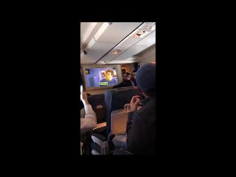 A group of Orthodox Jews censors a movie in a airliner