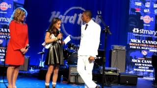 Camryn Weinbaum gives Nick Cannon a present from St. Mary