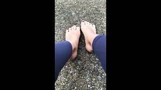 Sexy feet walk in grass