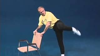 Superfoot Wallace training for high kicks with a chair