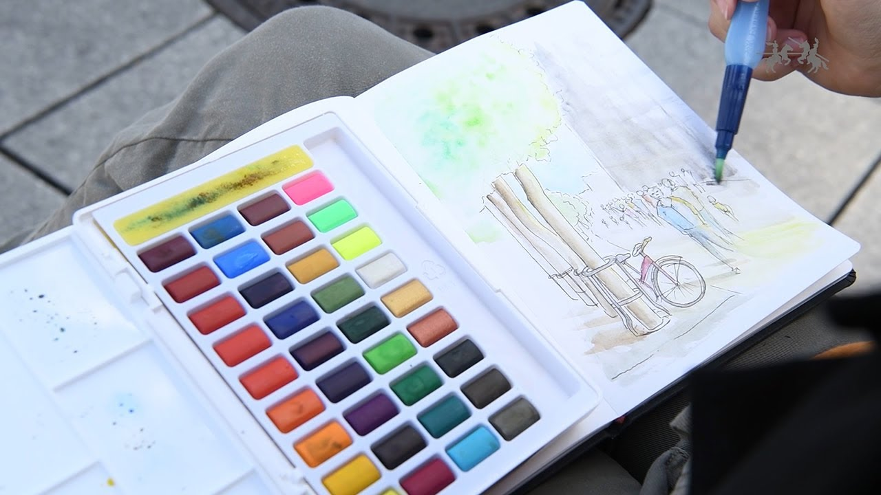 Painting with watercolours in pans