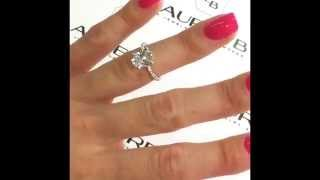 Oval Diamond Engagement Ring in a Thin Eternity Band