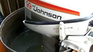 Johnson 9.9hp outboard running in test tank. New water pump installed.