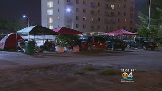 Apartment Residents Camp Out In Parking Lot After Buildings Condemned thumbnail