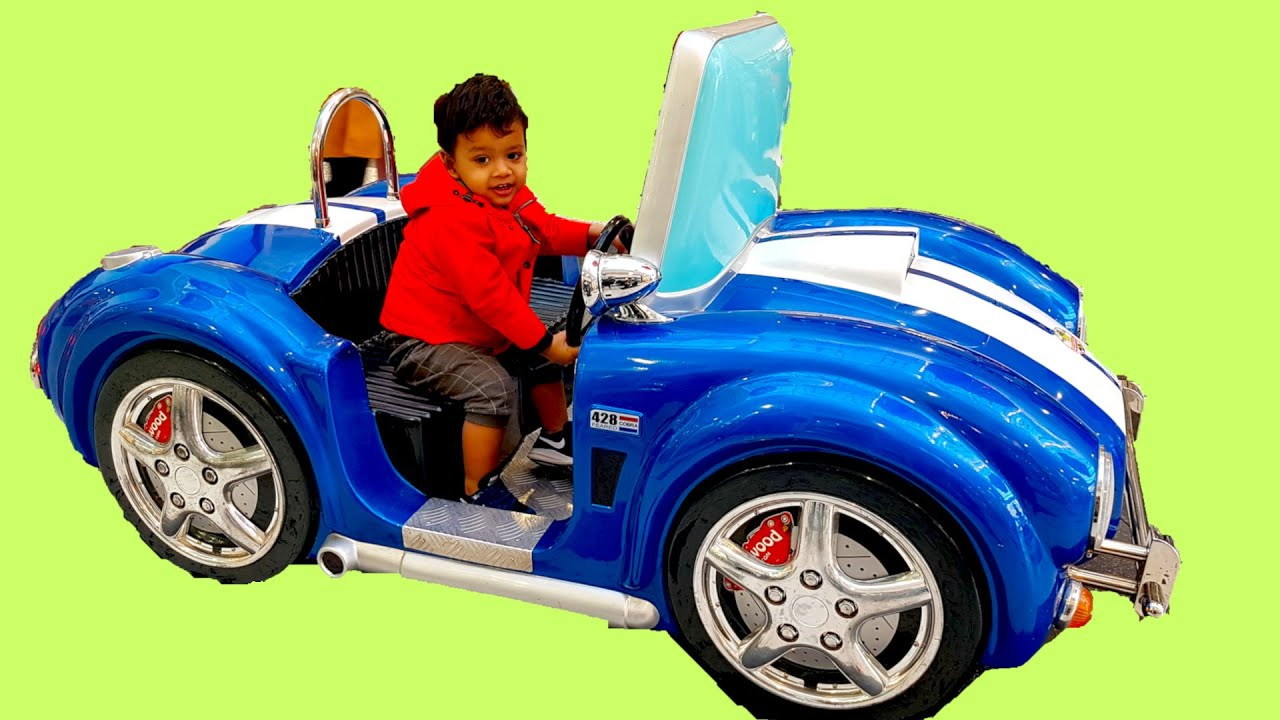Little Boy Playing on Blue Ride On Car | Wheel on the Bus Nursery Rhyme