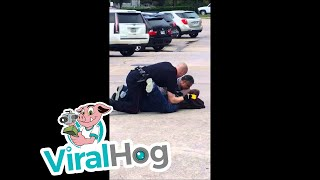 Suspect Resisting Arrest In Mall Parking Lot || ViralHog