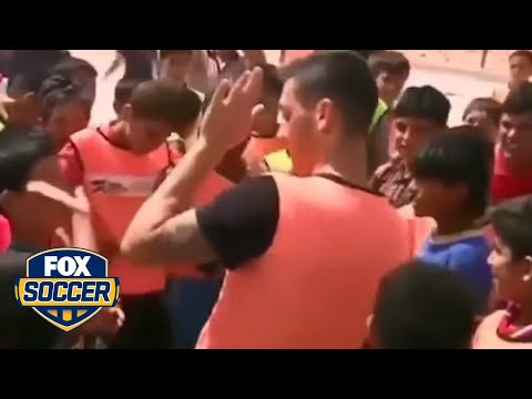 Mesut Ozil plays soccer with kids in refugee camp in Jordan