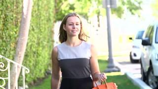 Business woman walking the street