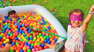 Kid Plays with Balls and Daddy Get's Stuck in the Muddy Puddles!