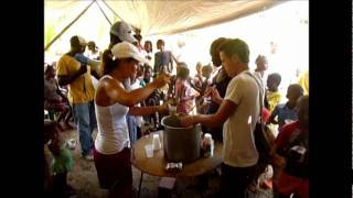 Volunteer Vacation Abroad; Oatmeal Distribution By Volunteers At Suncampdr, Dominican Republic