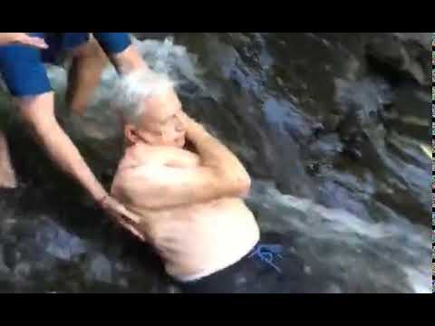Image result for Taking the plunge! 87-year-old slides down a 25-foot waterfall in the heart of the Costa Rican jungle