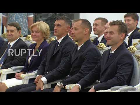 Russia: Putin awards state honours to Russian football team following WC run