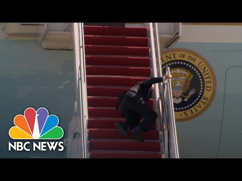 Watch: Biden Stumbles As He Boards Air Force One | NBC News NOW