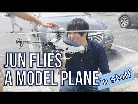 Dad teaches Jun how to fly a model plane