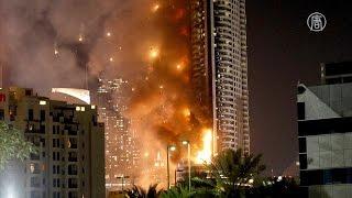 Салют в Дубае прошёл на фоне пожара в отеле (новости)(http://ntdtv.ru/ Салют в Дубае прошёл на фоне пожара в отеле. В Дубае, важнейшем финансовом центре Объединённых..., 2016-01-01T10:56:08.000Z)